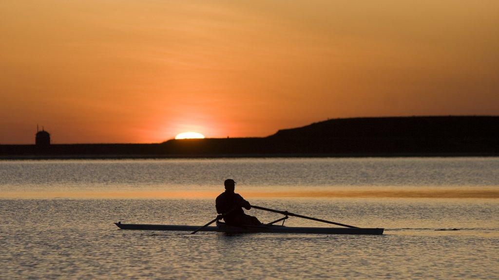 Boulder showing kayaking or canoeing, general coastal views and a sunset