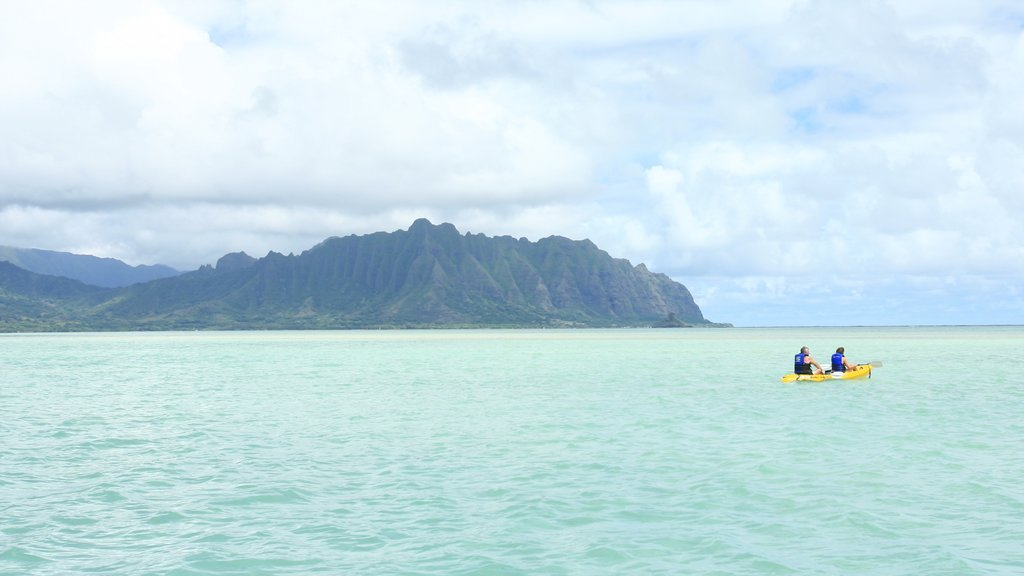 Kaneohe which includes kayaking or canoeing, general coastal views and mountains