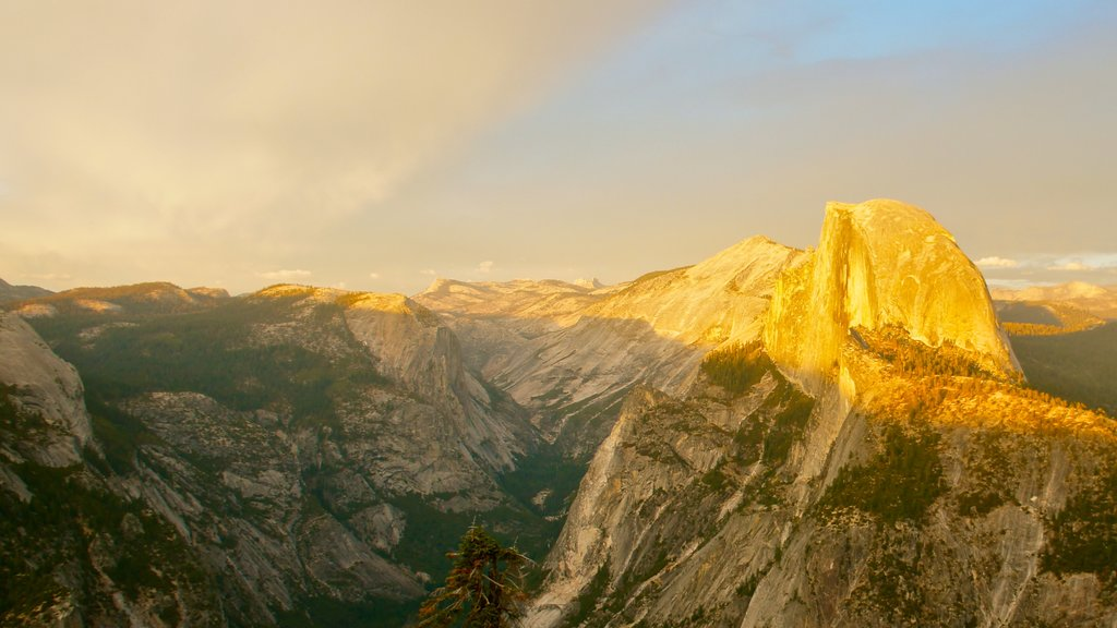 Yosemite Valley featuring a sunset, mountains and a gorge or canyon