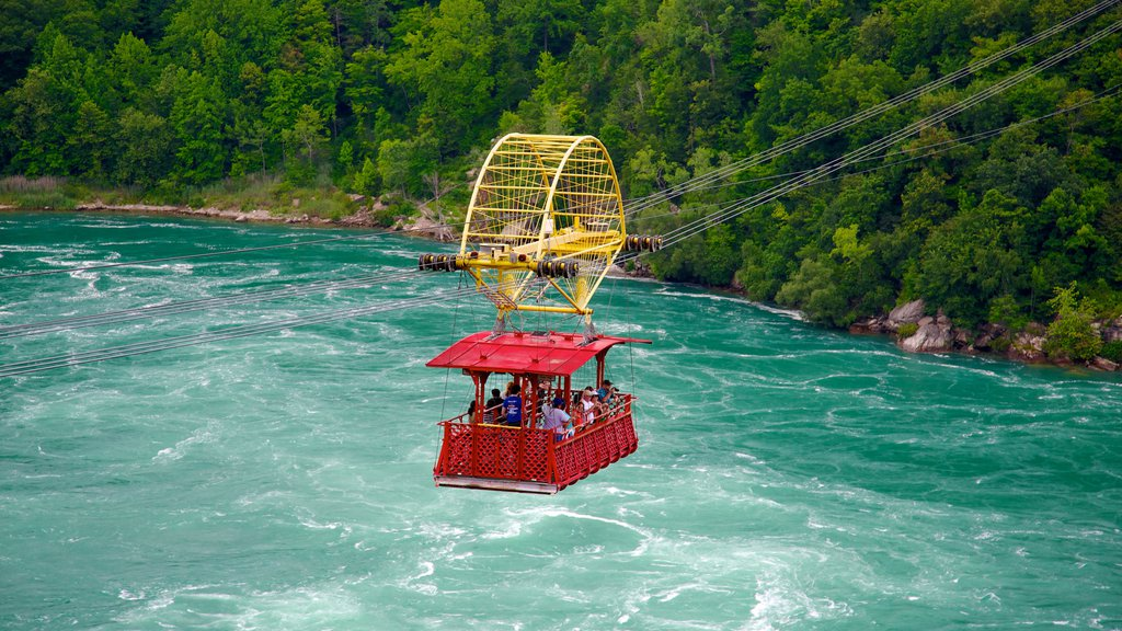 Whirlpool State Park featuring rapids and a river or creek as well as a large group of people