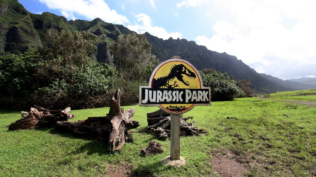 Kualoa Beach Park featuring mountains, a garden and signage