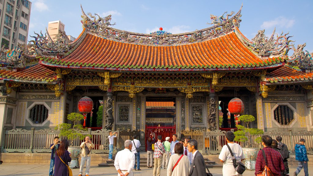 Longshan Temple which includes heritage architecture, a temple or place of worship and a city