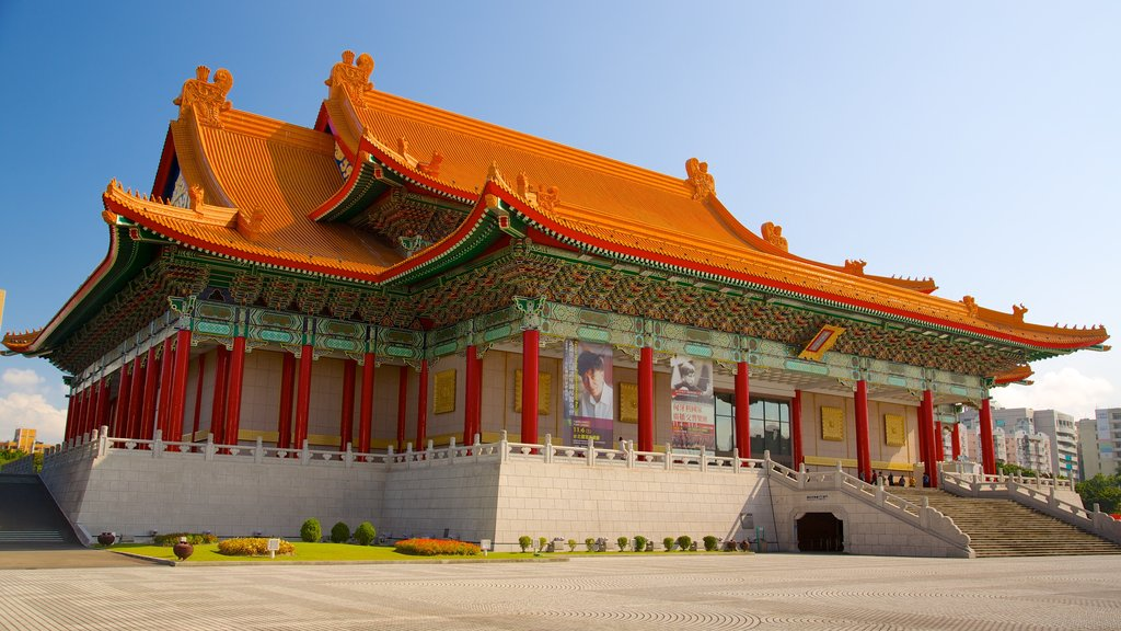 Taipei which includes heritage architecture, theater scenes and a temple or place of worship