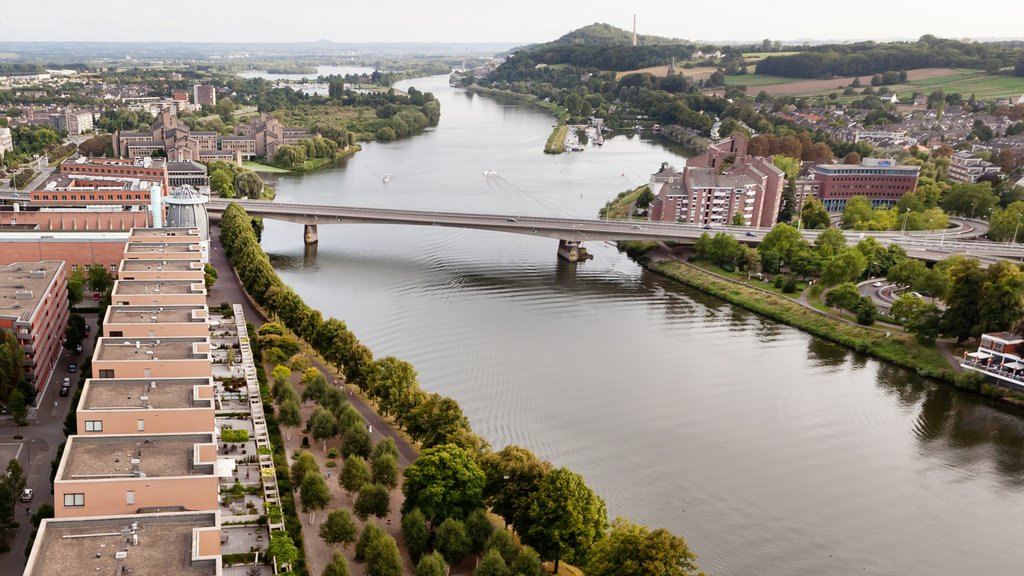 Maastricht showing a bridge, a river or creek and a city
