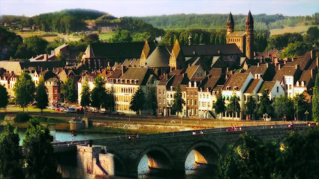 Maastricht showing heritage architecture, a river or creek and a bridge
