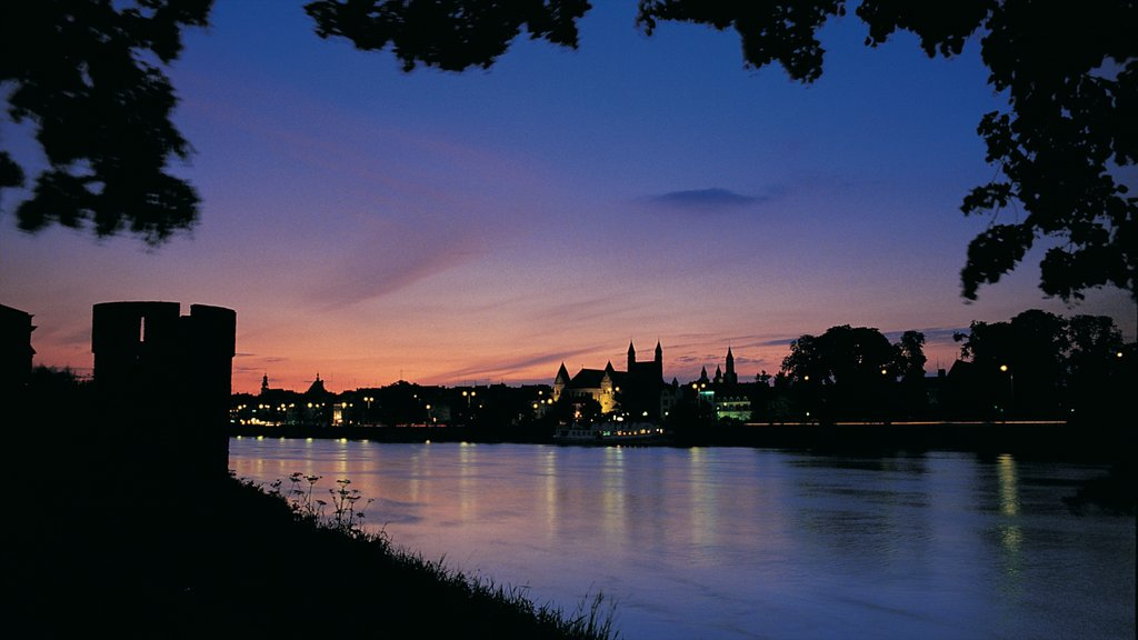 Maastricht which includes a city, night scenes and a river or creek
