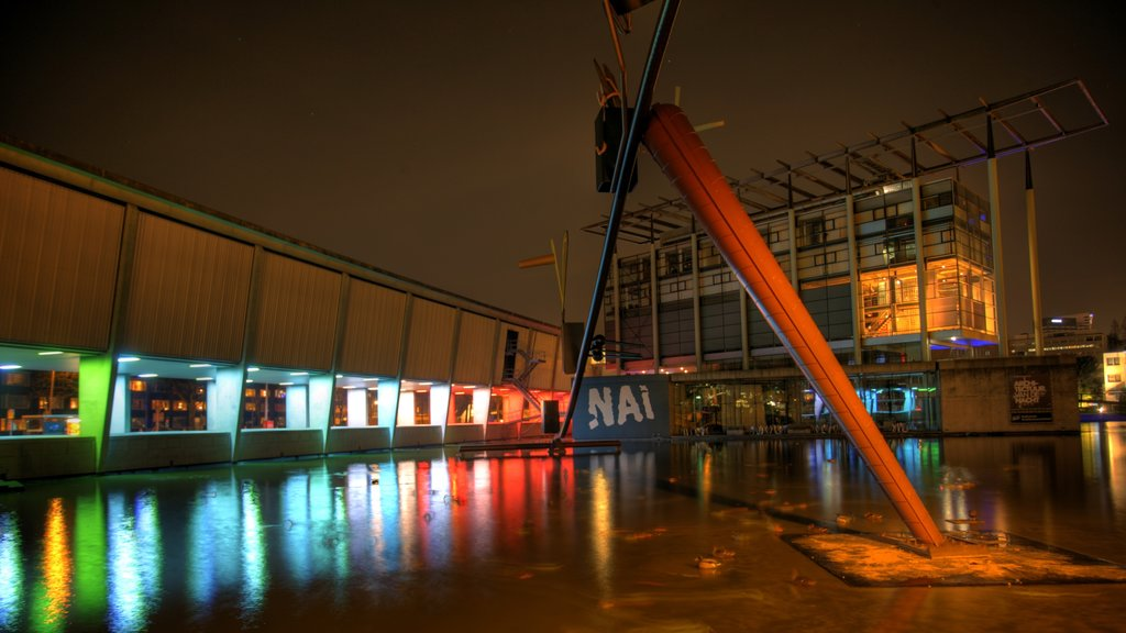 Rotterdam which includes modern architecture and night scenes
