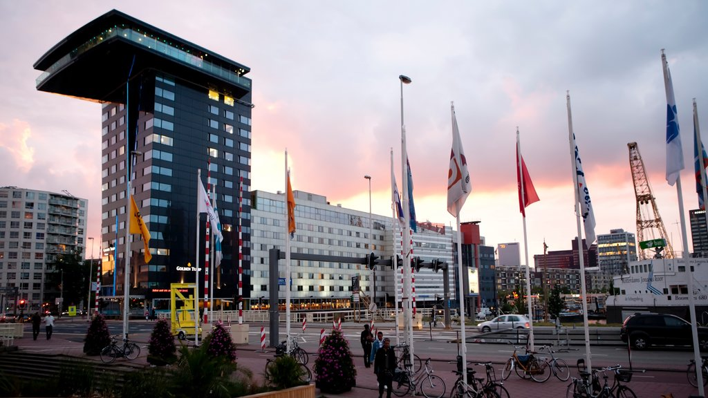 Rotterdam featuring street scenes, modern architecture and a sunset