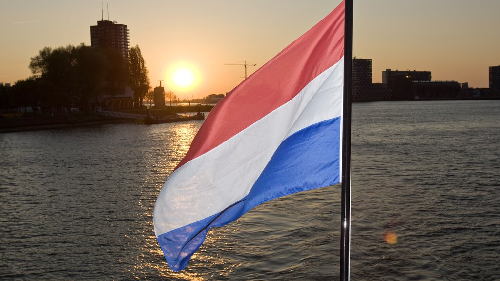 Rotterdam showing a bay or harbor, landscape views and a sunset