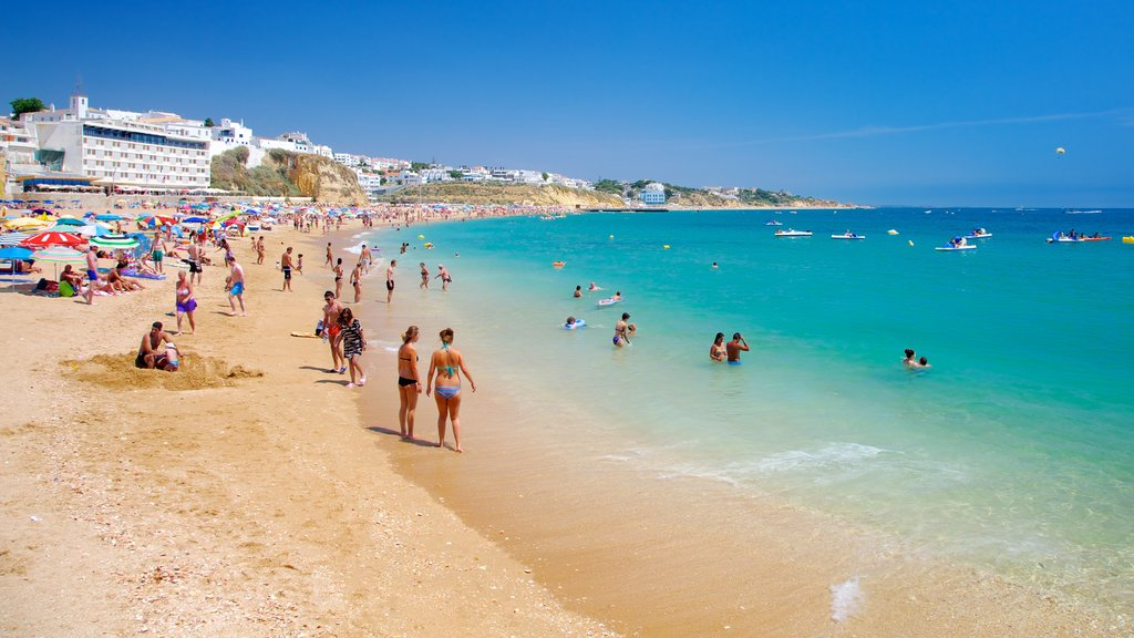 Albufeira featuring swimming, a coastal town and a beach
