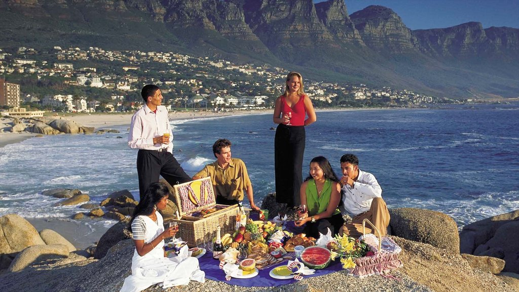 Camps Bay which includes picnicing, food and rocky coastline