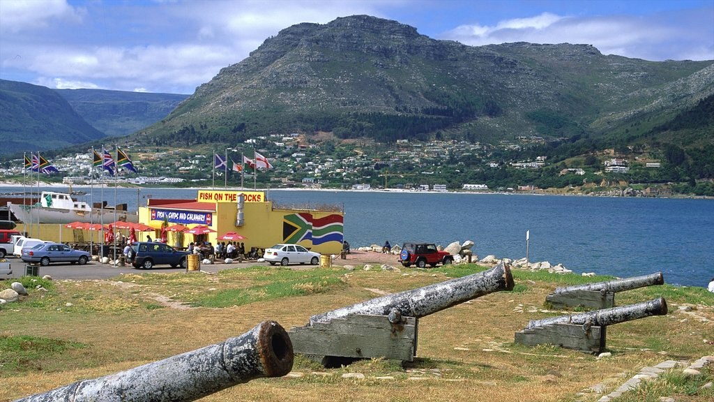 Hout Bay Beach showing a coastal town, outdoor art and a bay or harbor