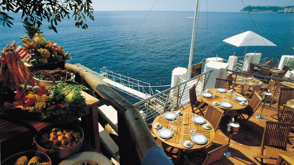 Mónaco ofreciendo vistas generales de la costa, comida y una bahía o puerto