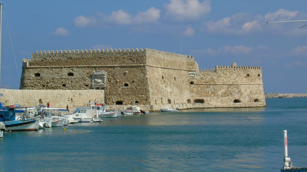 Heraklion featuring chateau or palace, a marina and heritage architecture