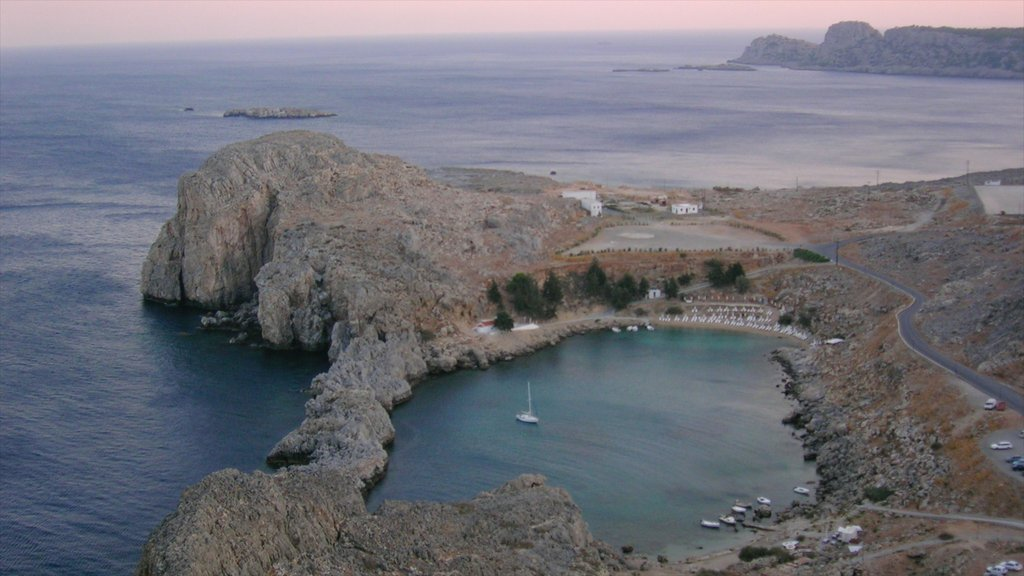 Lindos showing rugged coastline, a bay or harbor and general coastal views