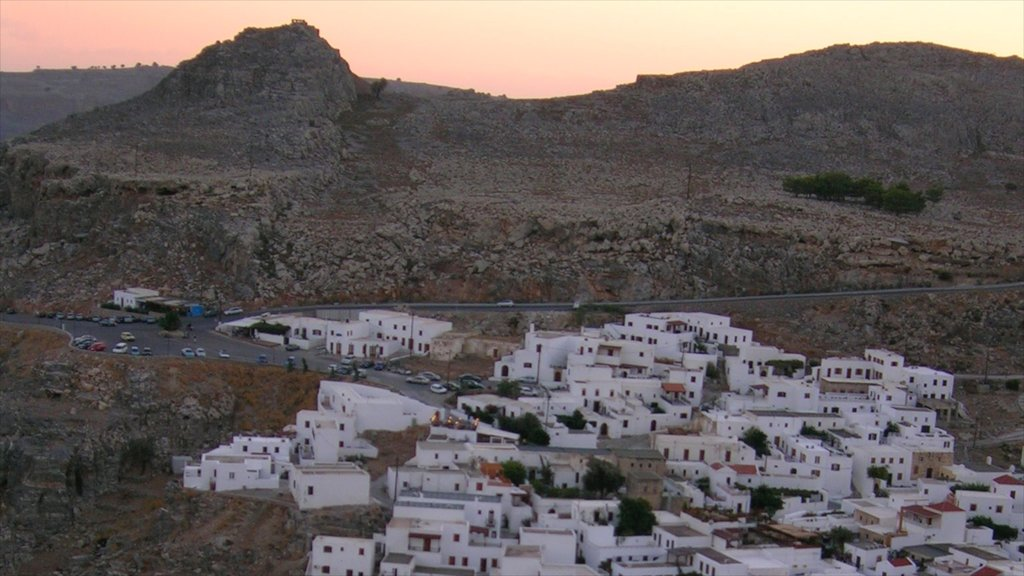 Lindos which includes a small town or village, a sunset and heritage architecture