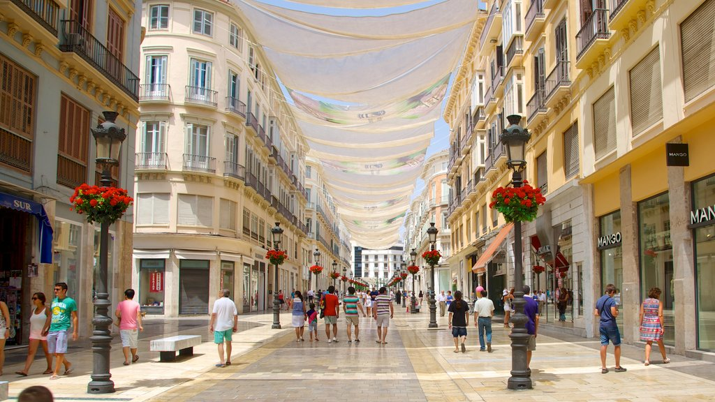 Malaga Historic Centre which includes heritage architecture, street scenes and shopping