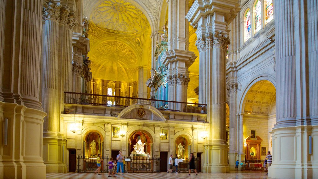 Malaga Cathedral which includes religious elements, a church or cathedral and interior views