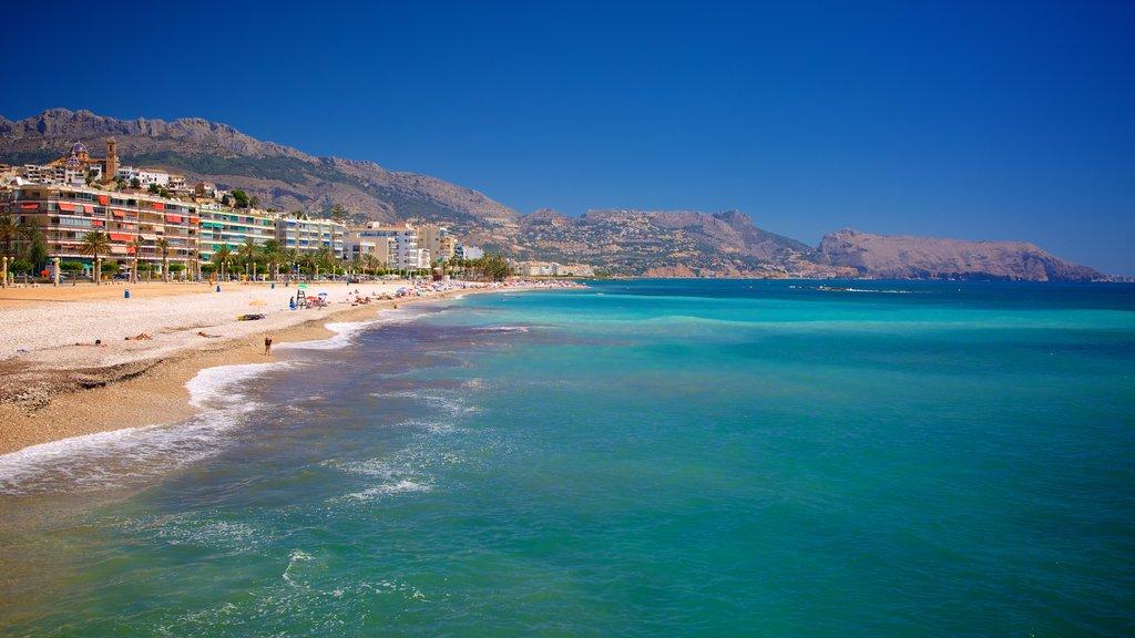 Altea showing a coastal town, mountains and a sandy beach