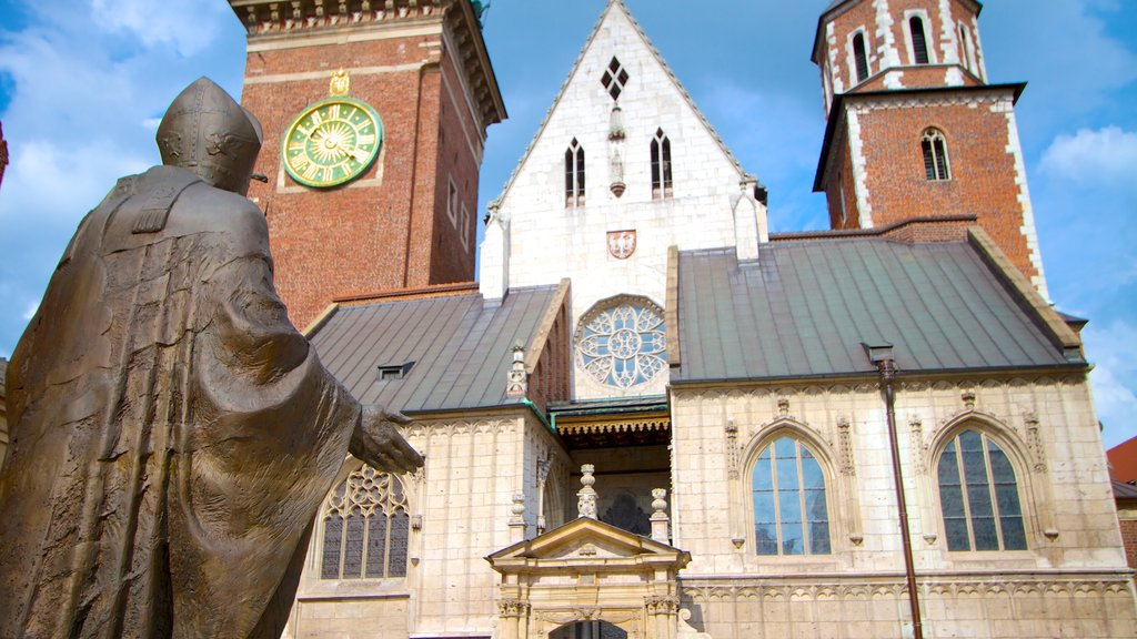 Wawel Cathedral featuring heritage architecture, a city and a statue or sculpture