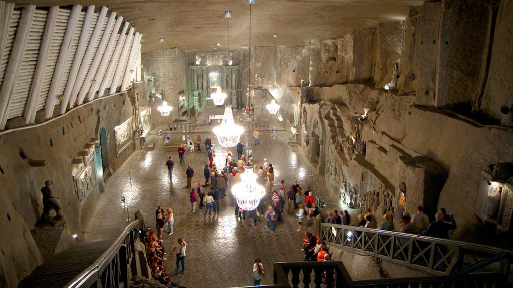 Wieliczka Salt Mine featuring heritage architecture and interior views as well as a large group of people