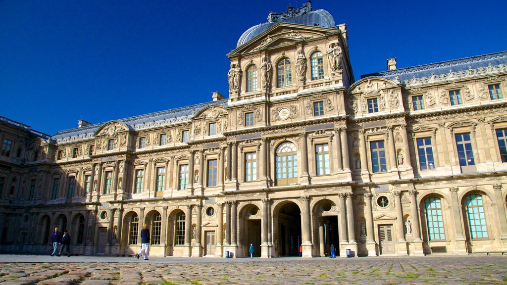 Louvre Museum showing heritage architecture and a castle