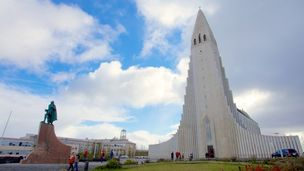 Reykjavik featuring a statue or sculpture, a church or cathedral and modern architecture