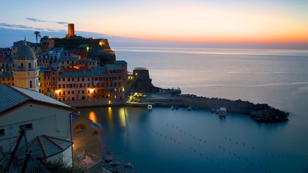 Vernazza showing a sunset, a bay or harbor and a coastal town