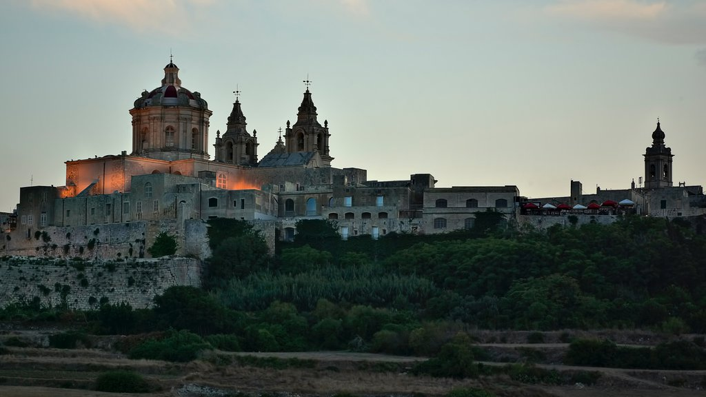 Mdina which includes a church or cathedral, heritage architecture and a sunset