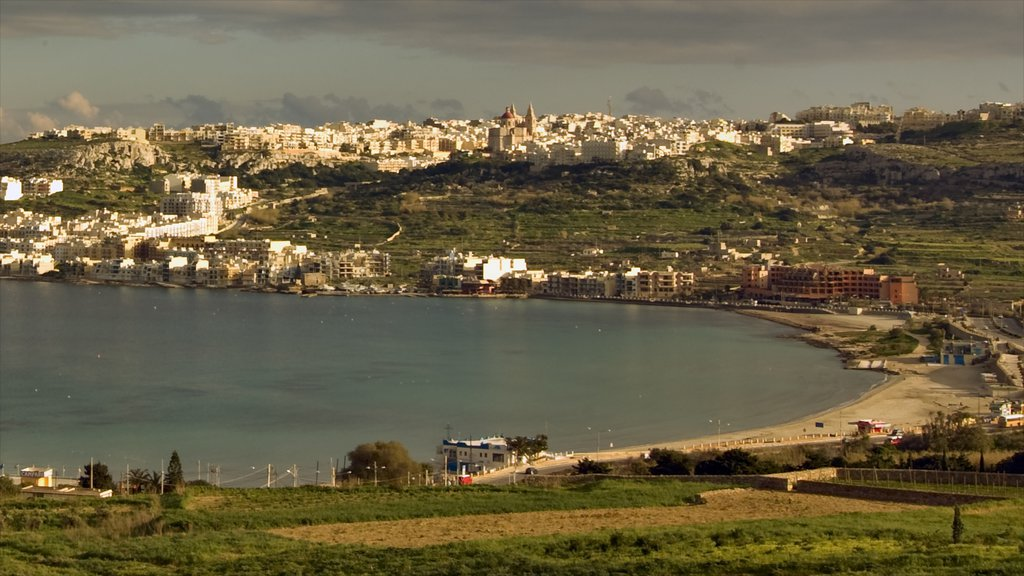 Mellieha which includes general coastal views, a sunset and a coastal town