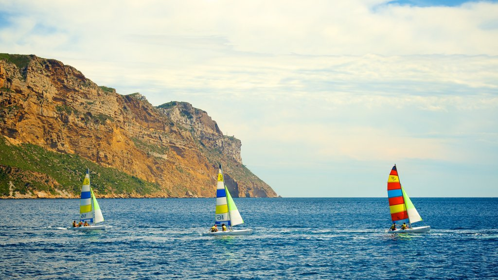 Calanques showing sailing and rugged coastline