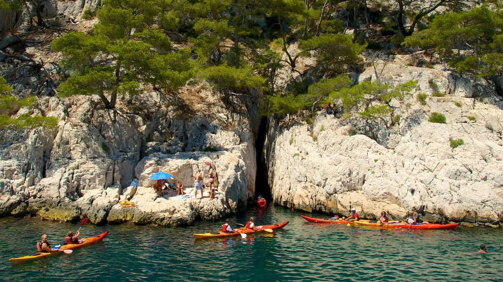 Calanques showing kayaking or canoeing and rugged coastline