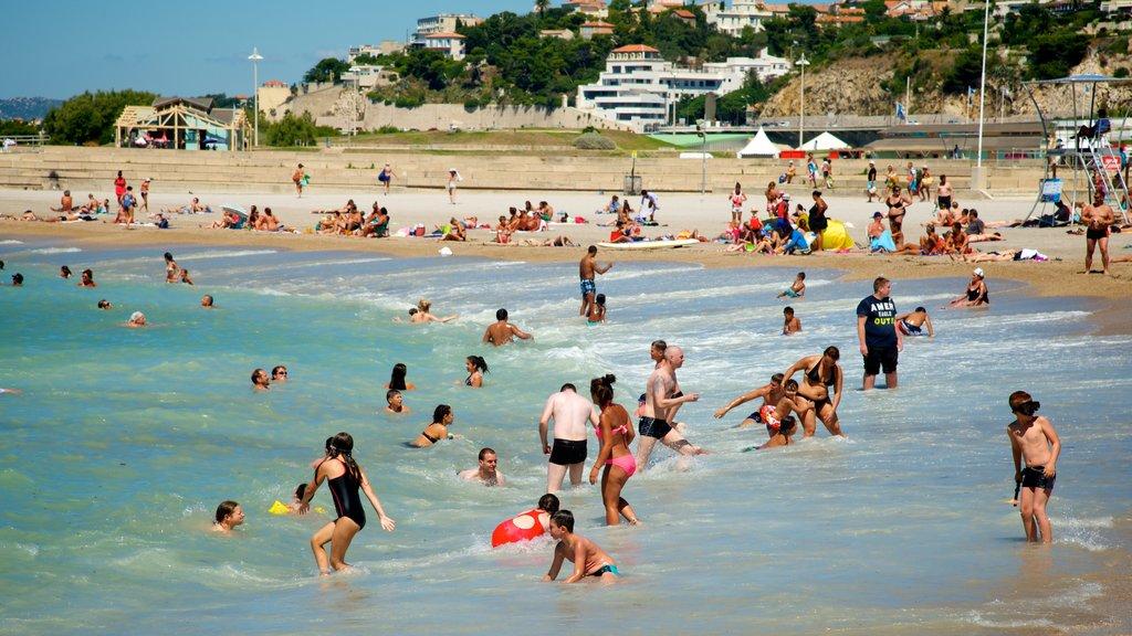 Prado Beach which includes a coastal town, a beach and swimming