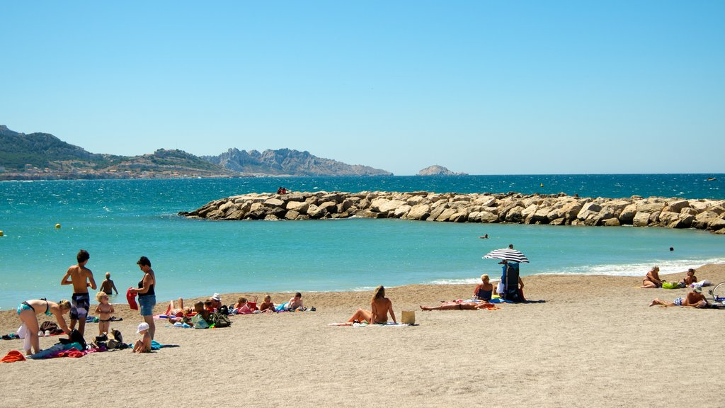 Prado Beach showing a beach and general coastal views as well as a small group of people