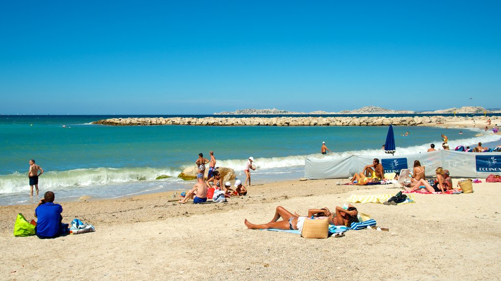 Borely Beach which includes a sandy beach and general coastal views as well as a large group of people