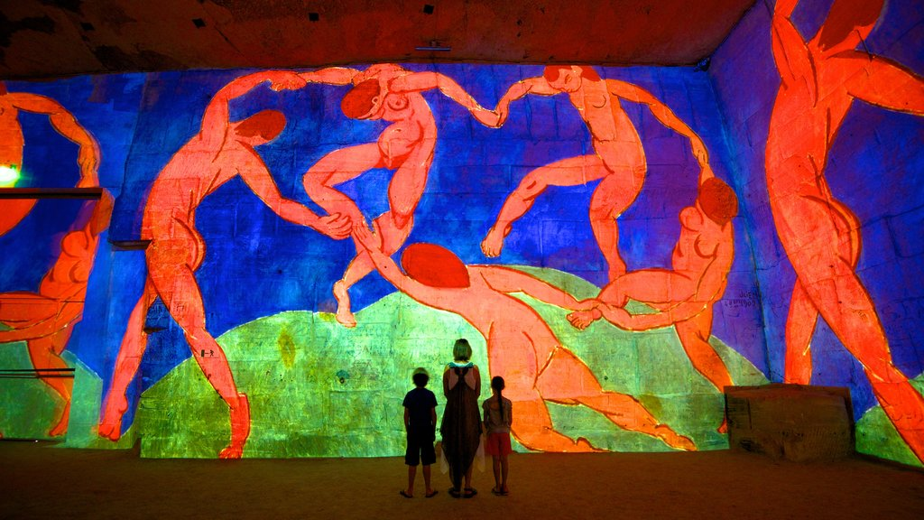 Carrieres de Lumieres featuring art and interior views as well as a family