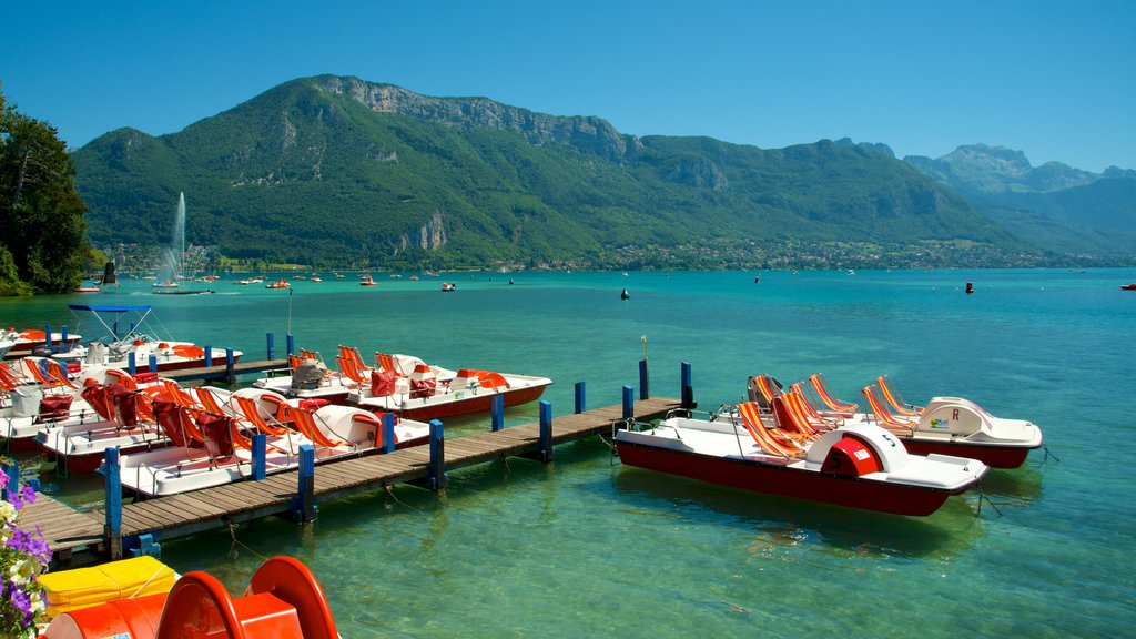 Annecy featuring mountains, a bay or harbor and watersports