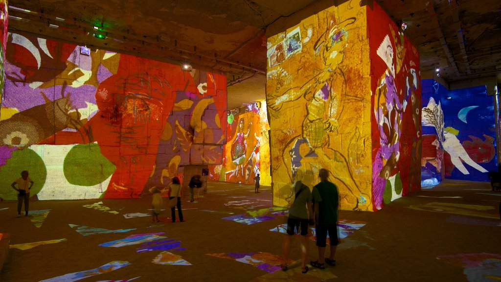 Carrieres de Lumieres which includes a church or cathedral, art and interior views