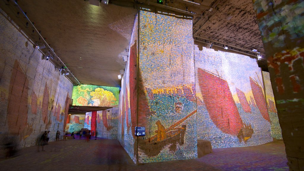 Carrieres de Lumieres showing a church or cathedral, art and interior views