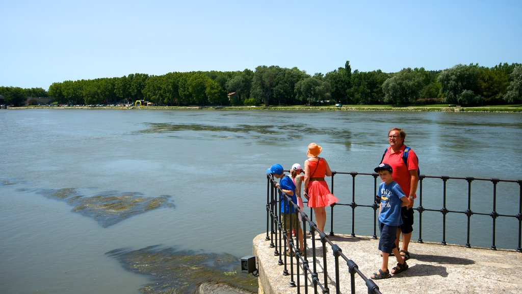 Avignon featuring a river or creek and views as well as a family