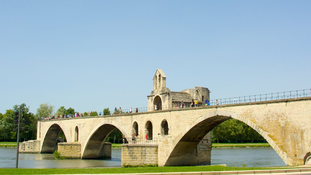 Pont d\'Avignon featuring a bridge, a river or creek and heritage architecture