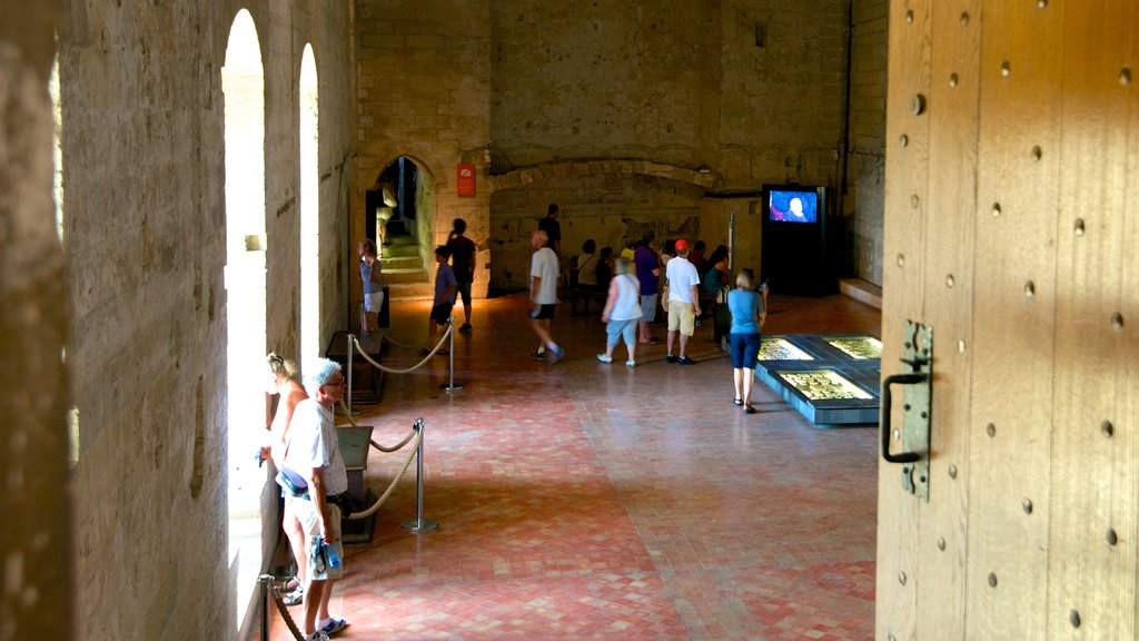 Palais des Papes featuring interior views, heritage elements and heritage architecture