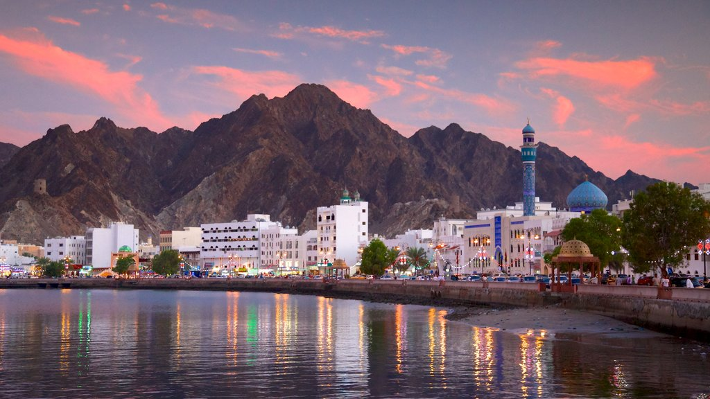 Muscat featuring general coastal views and a sunset