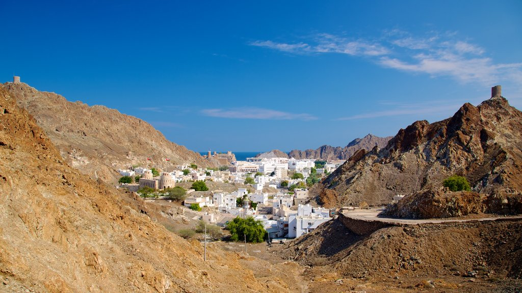 Oman which includes mountains and a small town or village