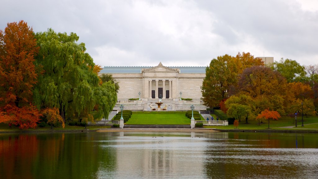 Cleveland Museum of Art showing heritage architecture, fall colors and a pond