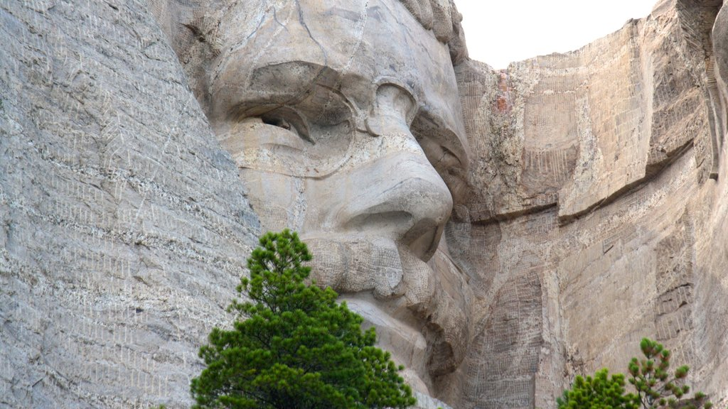 Mount Rushmore featuring a monument, outdoor art and mountains
