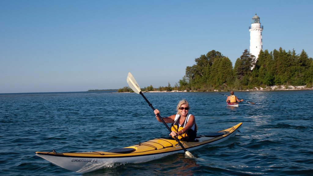 Door Peninsula featuring a lighthouse, general coastal views and kayaking or canoeing