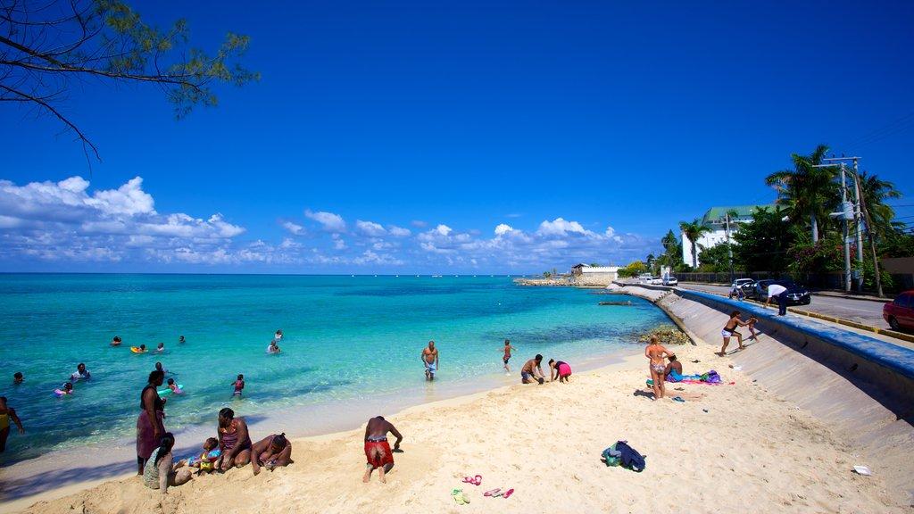 Montego Bay showing a coastal town, general coastal views and a sandy beach