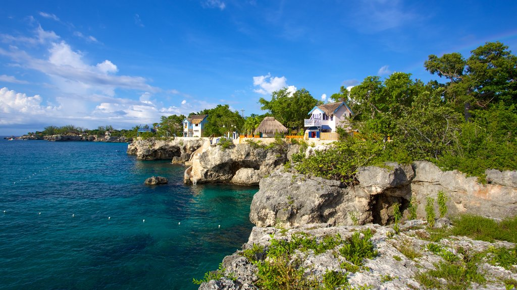 Negril Lighthouse which includes rocky coastline and a coastal town