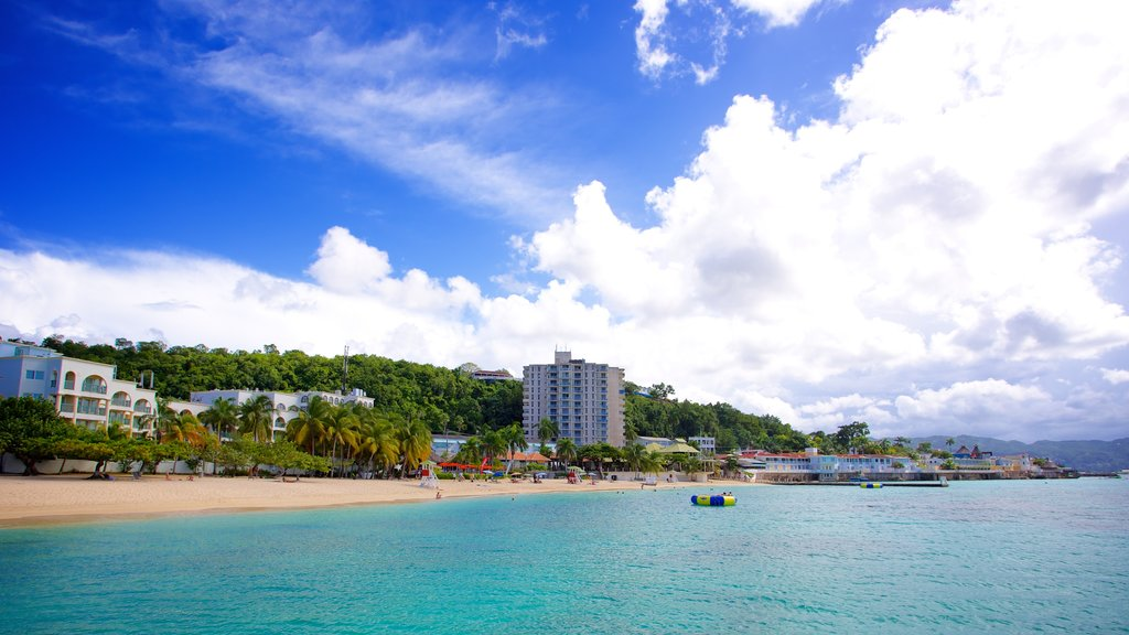 Doctor\'s Cave Beach featuring a beach, a coastal town and tropical scenes